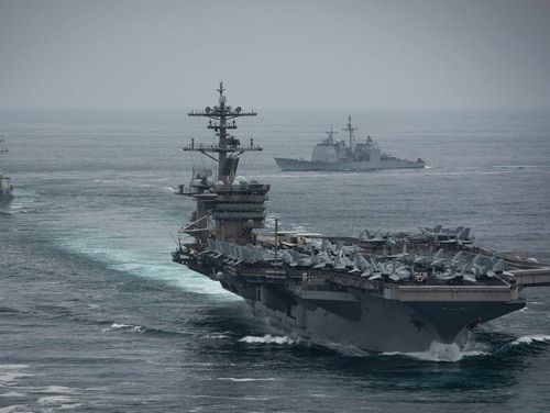Four more sailors assigned to the carrier Roosevelt, front, have been hospitalized. (MC2 Anthony Rivera/Navy)