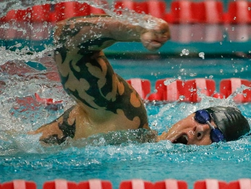 Air Force Tech. Sgt. Leonard Anderson competes in the 100-meter freestyle event at the US Olympic Training Center in Colorado Springs, Colorado, on Tuesday, September 30, 2014. (Mike Morones/Staff)