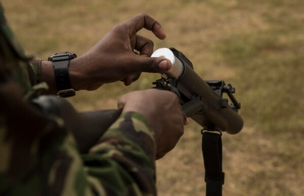 A Trinidad and Tobago service member loads the M79 with nonlethal ammunition during Exercise Tradewinds 2016, at Twickenham Park Gallery Range, Jamaica, June 24, 2016. (Cpl. Justin T. Updegraff/Marine Corps)