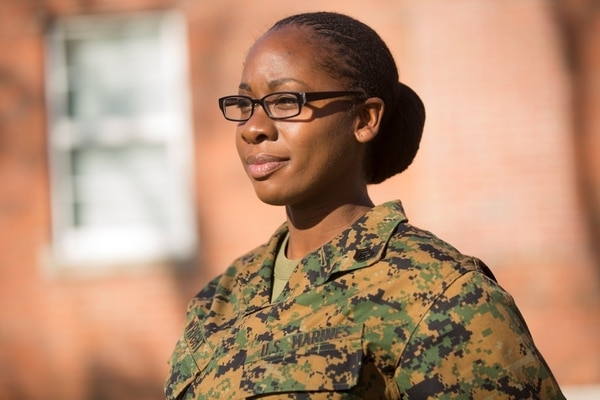 "SSgt. Cherie Wright, Supply Chief with 2nd Air Naval Gunfire Liaison Company, Camp Lejeune, N.C., shows off her hairstyle, Dec. 16, which was recently approved by the Marine Corps. Her research and submission resulted in MARADMIN 622/15, which includes the authorization of both twist and lock hairstyles, benefiting many females in the Marine Corps. Twist and lock hairstyles consist of ""sections of hair twisted to create a uniform ringlet or cordlike appearance"", according to the MARADMIN. Wright went through a long process of written proposals and oral presentations, to include briefing the commandant of the Marine Corps, before final approval from a uniform board. (U.S. Marine Corps photo by Cpl. Kirstin Merrimarahajara/released)"