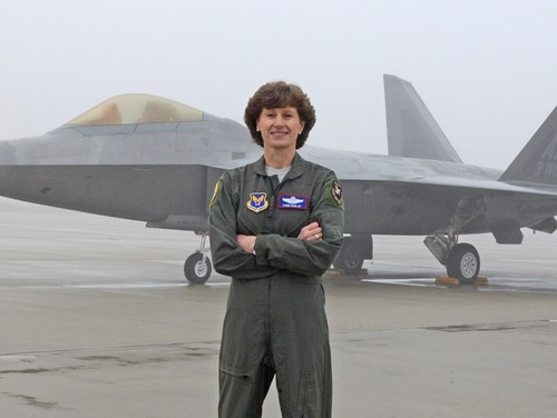 Maj. Gen. Dawn Dunlop poses for a photo in front of an F-22 Raptor at Edwards Air Force Base, Calif., Feb. 1, during the filming of a recruitment ad. Dunlop was removed from her position as director of the Defense Department's Special Access Programs Central Office on May 31, and is under several ongoing IG investigations. (Kenji Thuloweit/Air Force)