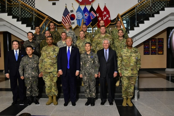 U.S. Secretary of State Rex Tillerson and President Donald J. Trump pose for a photo with U.S. and Republic of Korea troops at Camp Humphreys in the Republic of Korea on Nov. 7, 2017. (State Department)