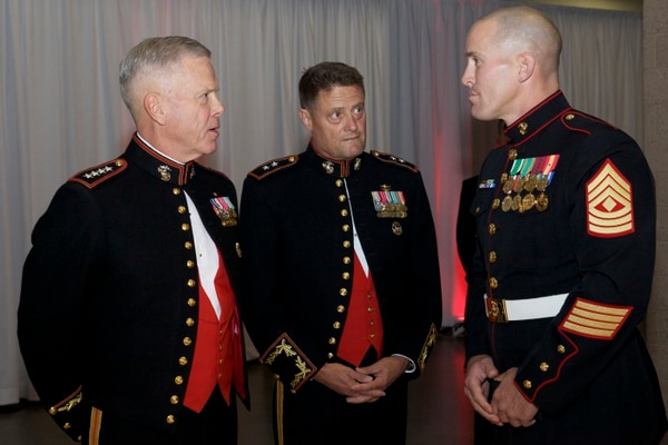 The Commandant of the Marine Corps, Gen. James F. Amos (left) speaks with the Commander of Marine Corps Special Operations Command (MARSOC), Maj. Gen. Mark Clark (center) and a Marine 1st sergeant at the MARSOC Birthday Ball in Wilmington, N.C., Nov. 16, 2012. The event was in celebration of the 237th Marine Corps birthday. (U.S. Marine Corps photo by Sgt. Mallory S. VanderSchans/Released)