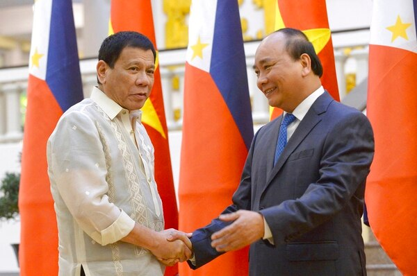 In this Sept. 29, 2016 photo, Philippine President Rodrigo Duterte, left, shakes hands with Vietnamese Prime Minister Nguyen Xuan Phuc as they meet at the Cabinet Office in Hanoi, Vietnam. President Duterte and Prime Minister Nguyen Xuan Phuc have discussed delineating their countries' maritime boundaries in the South China Sea, in what Beijing will likely perceive as another challenge to its claim to virtually the entire strategic waterway. Duterte said Friday, without elaborating, that he told Prime Minister Nguyen Xuan Phuc in a meeting in Indonesia that such boundary talks may take longer because the Philippines is still establishing its continental shelf limit - the country's outermost boundary. (Hoang Dinh Nam/AP)