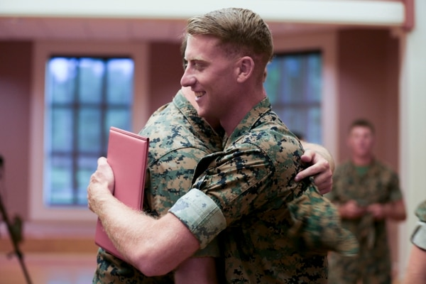 U.S. Marine Corps Cpl. Daniel L. Meinema, Echo Battery, 2nd Battalion, 10th Marine Regiment is congratulated following the conclusion of his Purple Heart Medal presentation ceremony at the Marston Pavilion, Camp Lejeune, N.C., July 28, 2016. Meinema received the medal due to wounds received during Operation Inharrant Resolve in Kara Soar Counter Fire Complex, Iraq. (U.S. Marine Corps photo by Cpl. Alexander Hill, 2d MARDIV Combat Camera/Released)