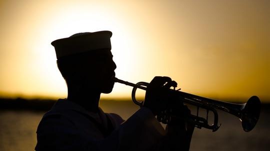 A Navy musician seaman plays