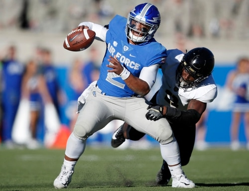 Air Force quarterback Arion Worthman, front, eludes a tackle by Army defensive back Gibby Gibson on Nov. 4, 2017, at Air Force Academy, Colo. (David Zalubowski/AP)