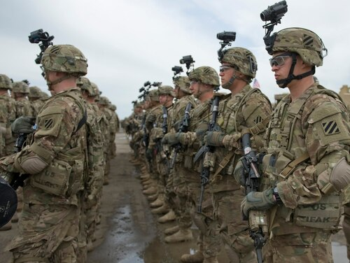 VAZIANI, Georgia Ð Soldiers from Company A, 2nd Battalion, 7th Infantry Regiment, 1st Brigade, 3rd Infantry Division stand in formation during a ceremony kicking off exercise Noble Partner 15. Noble Partner is a field training and live-fire exercise between the U.S. Army and the Georgian military to support Georgia's participation in the NATO Response Force and build military ties between the two nations. (U.S. Army Photo by Sgt. Daniel Cole, Army Europe Public Affairs)