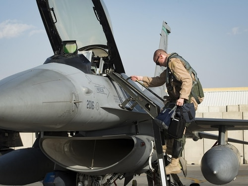 A 555th Expeditionary Fighter Squadron pilot exits an F-16 Fighting Falcon after landing at Bagram Airfield, Afghanistan, Aug. 31. The recent deployment of six additional F-16s to Afghanistan helped the coalition drop the highest one-month total of weapons there in seven years. (Staff Sgt. Benjamin Gonsier/Air Force)