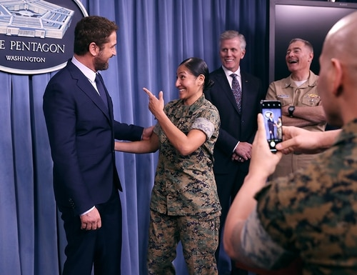 Scottish actor Gerard Butler poses for photographs with members of the U.S. military on Oct. 15, 2018, following a news briefing about his new submarine action film