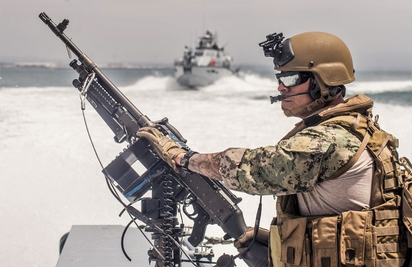 Chief Quarter Master Jaime Villalobos, from Los Angeles, California, mans a M240B machine gun aboard a MKVI patrol boat. (U.S. Navy photo by BMC Nelson Doromal Jr)
