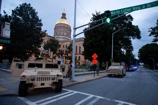 Members of the Georgia National Guard stand outside the State Capitol on July 7, 2020, in Atlanta. Georgia Gov. Brian Kemp mobilized the Guard after a surge in gun violence over the weekend. (John Bazemore/AP)