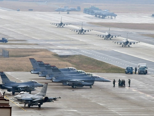 U.S. Air Force F-16 Fighting Falcon fighter aircraft, assigned to the 36th Fighter Squadron, participate in an elephant walk during Exercise Vigilant Ace 18 at Osan Air Base, South Korea, on Dec. 3, 2017. (Staff Sgt. Franklin R. Ramos/U.S. Air Force)