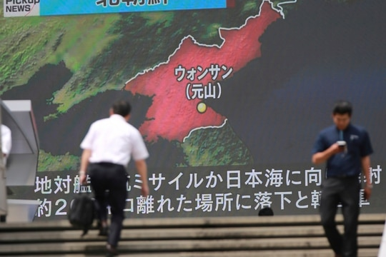 A screen shows a news program in Tokyo about a North Korean missile launch. The North's Kumsong-3 missile is a variant of the Russian Kh-35 anti-ship cruise missile. (Eugene Hoshiko/AP)