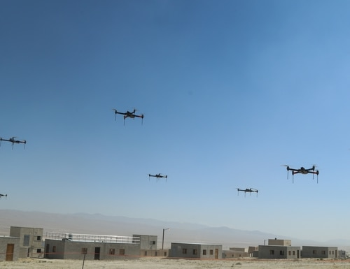 The 11th Armored Cavalry Regiment and the Threat Systems Management Office push a swarm of 40 drones through a town during the battle of Razish at the National Training Center on May 8, 2019. (Pvt. 2nd Class James Newsome/U.S. Army)
