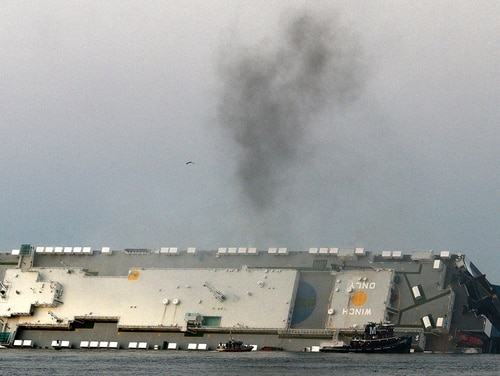Smoke rises from a cargo ship that capsized in Georgia's St. Simons Sound on Sunday. (Bobby Haven/The Brunswick News via AP)