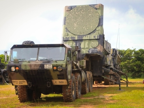 A patriot missile radar system set assigned to 1st Battalion, 1st Air Defense Artillery Regiment, sits in a training area during the units table gunnery training exercise on Kadena Air Base in Japan, Oct. 19, 2017. The Army is looking to replace the radar with a next-generation system in the near-term (Photo by Capt. Adan Cazarez/U.S. Army)