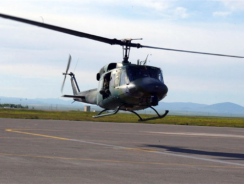 A UN-H1 Huey helicopter from Joint Base Andrews was shot from the ground while flying on a training mission over Virginia Monday, and conducted an emergency landing at Manassas Regional Airport. A crew member's hand was injured. (Air Force)