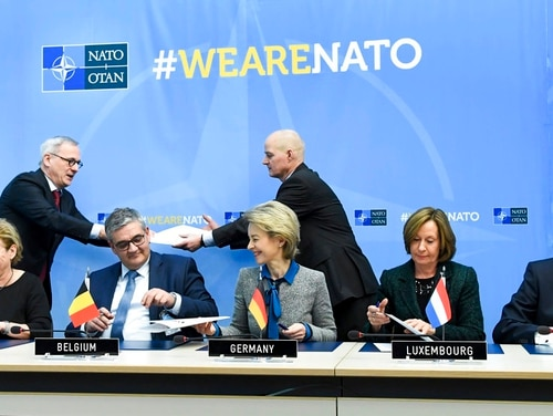 From left, Dutch Defense Ank Bijleveld, Belgian Defense Minister Steven Vandeput, German Defense Minister Ursuala von der Leyen, Luxembourg's Permanent NATO Representative Arlette Conzemius and Norway's Defense Minister Frank Bakke-Jensen participate in a signing ceremony at NATO headquarters in Brussels on Wednesday, Feb. 14, 2018. Ministers from Belgium, Germany, the Netherlands, Norway and Luxembourg attended a signing ceremony on Wednesday for the European multinational fleet of Airbus tanker transport aircraft. (Frederic Sierakowski/Pool via AP)