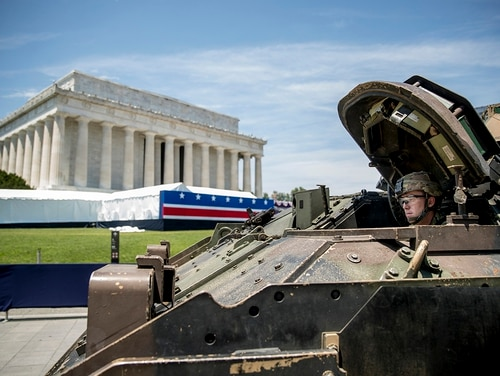 One of two Bradley Fighting Vehicles waits to be driven into place in front of the Lincoln Memorial for President Donald Trump's