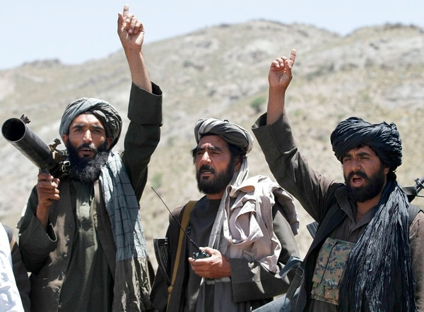 In this May 27, 2016, file photo, Taliban fighters react to a speech by their senior leader in the Shindand district of Herat province, Afghanistan. (Allauddin Khan/AP)