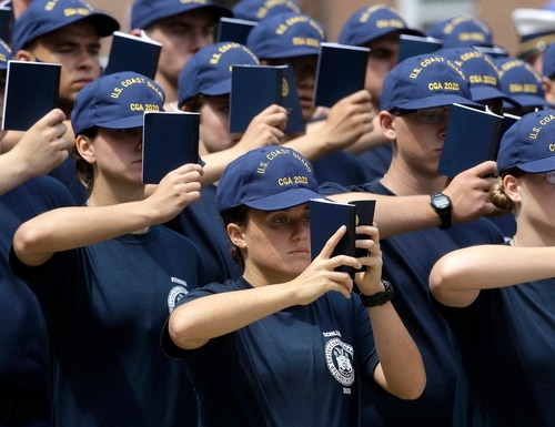U.S. Coast Guard swabs hold cadet handbooks as they assemble before swearing-in ceremonies, Monday, June 27, 2016, at the U.S. Coast Guard Academy, in New London, Conn. Forty years after military service academies opened their doors to women, the U.S. Coast Guard Academy is marking the milestone Monday at its annual reporting-in day, when it welcomes a class with a record 38 percent female cadets. (AP Photo/Steven Senne)