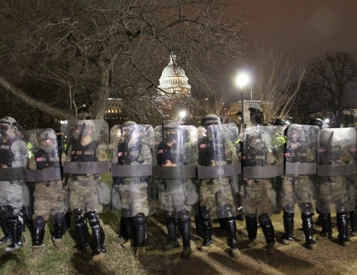 The National Guard arrives to push back protesters from the Capitol on Jan. 6, 2021. (Kyle Rempfer/Staff)