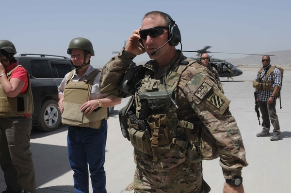 U.S. Army Maj. Gen. Robert Abrams, center, the commanding general of the 3rd Infantry Division, prepares to board a helicopter at Kandahar Airfield in Kandahar province, Afghanistan, April 18, 2013. Abrams accompanied six members of Congress on a tour of U.S. military facilities in Afghanistan. (U.S. Army photo by Sgt. Ashley Bell/Released)