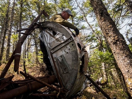 Air Force Master Sgt. Thomas Ricketson, a medic with the Defense POW/MIA Accounting Agency examines a piece of aircraft wreckage during an investigation in the Primorsky Krai region of Russia, May 20, In a similar mission, the agency brought home Sgt. Alfonso Duran's remains. (Sgt. Lauren Gramley/Marine Corps)