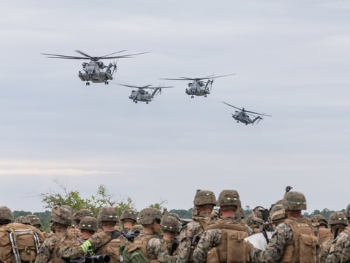 U.S. Marines observe CH-53E Super Stallions during Exercise Steel Pike. Marines with 3rd Battalion, 2nd Marine Regiment and 1st Battalion, 6th Marine Regiment, 2nd Marine Division. The aircraft are with Marine Heavy Helicopter Squadron (HMH) 366 and Marine Heavy Helicopter Squadron (HMH) 464, Marine Aircraft Group 29, 2nd Marine Aircraft Wing. (Cpl. Jered T. Stone/Marine Corps)