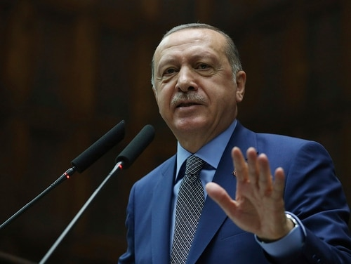 Turkey's President Recep Tayyip Erdogan addresses supporters at the parliament, in Ankara, Tuesday, Oct. 30, 2018. (Presidential Press Service via AP, Pool)