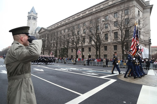 Marine Sgt. Ryan Tuszynsk salutes the Joint Service color guard passing by Freedom Plaza during the 58th Presidential Inauguration in 2017. (Sgt. Kalie Jones/Army)