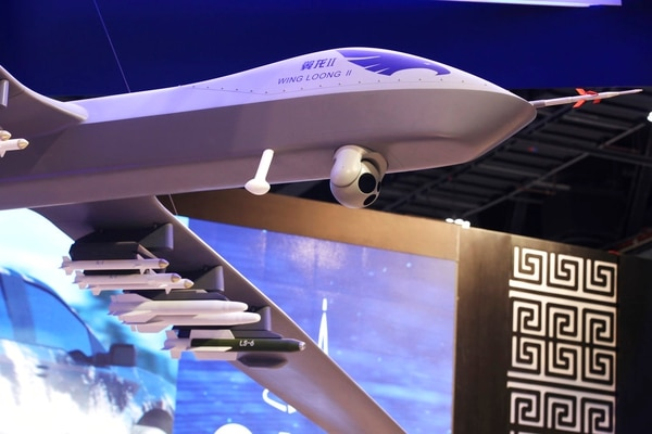 A model of the Wing Loong II weaponized drone hangs above the stand for the China National Aero-Technology Import & Export Corp. at a Feb. 18 military drone conference in Abu Dhabi, United Arab Emirates. Across the Middle East, countries locked out of purchasing U.S.-made drones due to rules over excessive civilian casualties are being wooed by Chinese arms dealers, who are world's main distributor of armed drones. The sales are helping expand Chinese influence across a region crucial to American security interests and bolstering Beijing's ambitions of being a world leader in high-tech arms sales. (Jon Gambrell/AP)