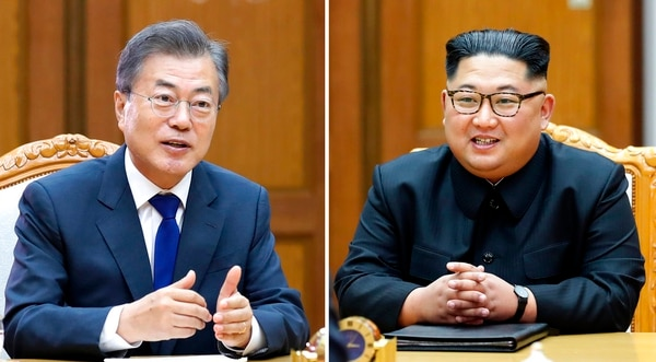 This combination of the May 26, 2018 provided May 27, 2018, by South Korea Presidential Blue House via Yonhap News Agency, shows South Korean President Moon Jae-in, left, and North Korean leader Kim Jong Un, right, during their meeting at the northern side of the Panmunjom in North Korea. (South Korea Presidential Blue House/Yonhap via AP)