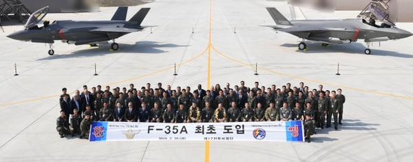 U.S and South Korean soldiers pose with two F-35A fighter jets at Chungju Air Base on March 29, 2019, in Chungju, South Korea. Two F-35As were received by South Korea after the U.S. approved a plan to export Lockheed Martin's stealth fighters. (South Korea Defense Acquisition Program Administration via Getty Images)
