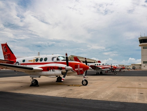 A line of Navy T-44C Pegasus' parked on the flightline aboard Naval Air Station Corpus Christi on July 23, 2019, in Texas. (1st Lt. Pawel Puczko/Marine Corps)