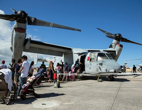 1st Marine Aircraft Wing service members and residents of Okinawa participate in the Futenma Flight Line Fair on Marine Corps Air Station Futenma, Okinawa, Japan, July 8, 2018. (Lance Cpl. Alexia Lythos/Marine Corps)