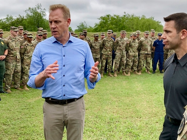 Acting Defense Secretary Patrick Shanahan, left, speaks with troops May 11, 2019, near McAllen, Texas, about the military's role in support of the Department of Homeland Security's effort to secure the Southwest border. At right is Kevin McAleenan, acting DHS secretary. (Robert Burns/AP)