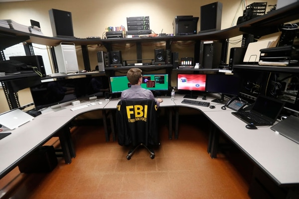 In this Tuesday, July 31, 2018, photo, an FBI employee works in a computer forensics lab at the FBI field office in New Orleans. (Gerald Herbert/AP)