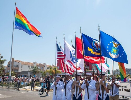 Color Guard members from the Navy and Marine Corps march at the San Diego Pride Parade on July 14, 2018. (Mass Communication Specialist 3rd Class Nicholas Burgains/Navy)