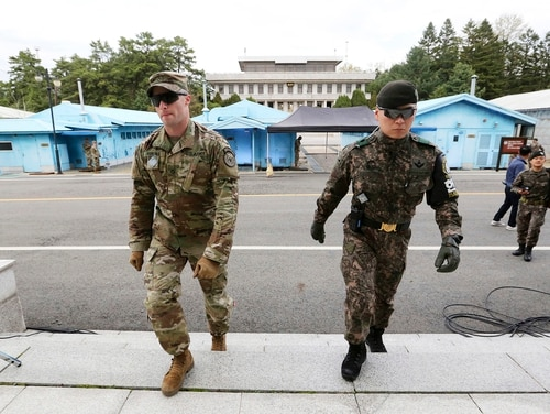 In this April 26, 2019, file photo, South Korean and U.S. Army soldiers patrol during a rehearsal to mark the first anniversary of a summit between South Korean President Moon Jae-in and North Korean leader Kim Jong Un on April 27, at the border village of Panmunjom in the demilitarized zone (DMZ) between the two Koreas in Paju, South Korea. (Ahn Young-joon/AP)