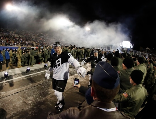 Cadets sitting field level congratulate Kings players after their win Saturday against the Avalanche. (David Zalubowski/AP)