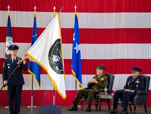 Air Force Gen. John W. Raymond, commander of the U.S. Space Command, right, and Marine Corps Gen. Joseph F. Dunford Jr., chairman of the Joint Chiefs of Staff, watch during the presentation of the new U.S. Space Command colors Monday, Sept. 9, 2019, during a ceremony to recognize the establishment of the United States Space Command at Peterson Air Force Base in Colorado Springs, Colo. (Christian Murdock/The Gazette via AP)