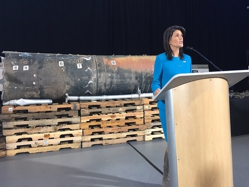 U.S. Ambassador to the United Nations Nikki Haley stands in front of the reconstructed components of two ballistic missiles that U.S. intelligence assesses were provided by Iran. The missiles were fired by Houthi rebels in Yemen against targets in Saudi Arabia. (Tara Copp/Military Times)