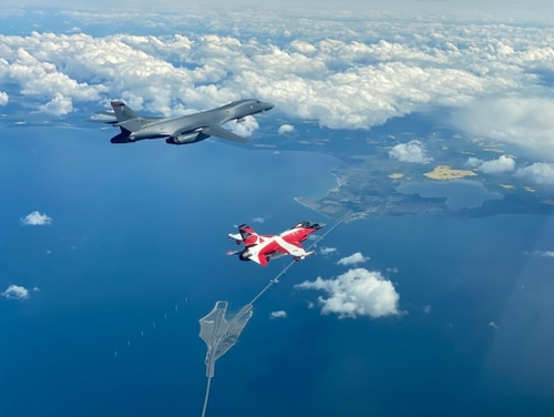 A B-1B Lancer flies with a Danish F-16 during a training mission for Bomber Task Force Europe, May 5, 2020. (Danish air force)