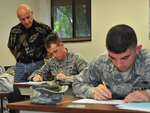 A test control officer at Tyndall Air Force Base observes airmen as they take the test for promotion. The Air Force is extending its testing deadlines for airmen eligible for promotion to staff sergeant as a result of the coronavirus pandemic. (A1C Sergio Gamboa/Air Force)