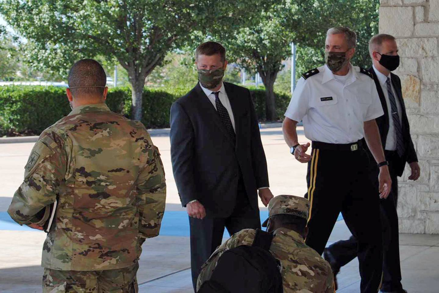 Secretary of the Army Ryan McCarthy, center, into the Killeen Civic and Conference Center on Aug. 6, 2020, ahead of a meeting with local officials in Killeen, Texas.
