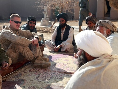 091215-M-6770H-036 U.S. Marine Corps Capt. Jason C. Brezler, with 3rd Battalion, 4th Marine Regiment, meets with Afghan leaders in Now Zad, Afghanistan, on Dec. 15, 2009. Marines meet with town elders to discuss the reconstruction process. DoD photo by Cpl. Albert F. Hunt, U.S. Marine Corps. (Released)