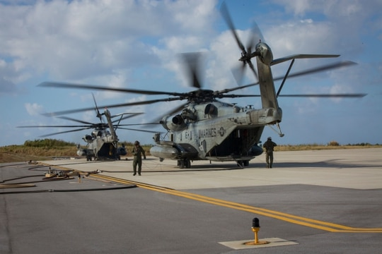 A CH-53E helicopter with Marine Heavy Helicopter Squadron 466, 1st Marine Aircraft Wing, supplies fuel to Marines with Marine Wing Support Squadron 171.(Lance Cpl. Ryan Persinger/ Marine Corps)