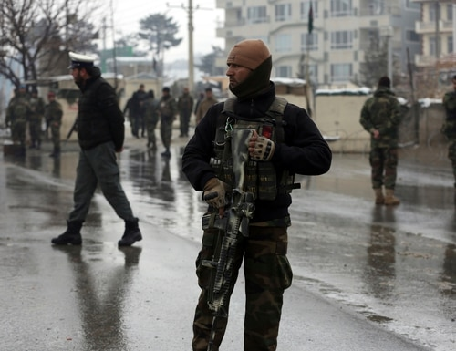 National army soldiers stand guard at the site of suicide attack near the military academy in Kabul, Afghanistan, Tuesday, Feb. 11, 2020. A suicide bomber targeting a military academy in the Afghan capital on Tuesday killed at least six people, including two civilians and four military personnel, the Interior Ministry said. (Rahmat Gul/AP)